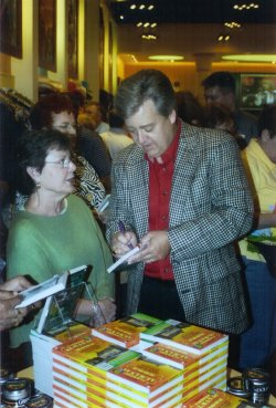 "Bob signs an Almanac for Evalyn ""Tootsie"" Holmes"